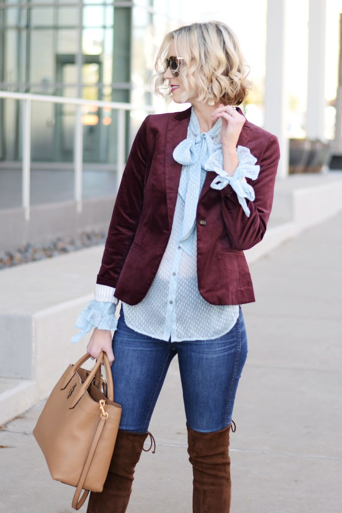 burgundy velvet blazer, blue tie blouse, blonde bob hair styled with curls