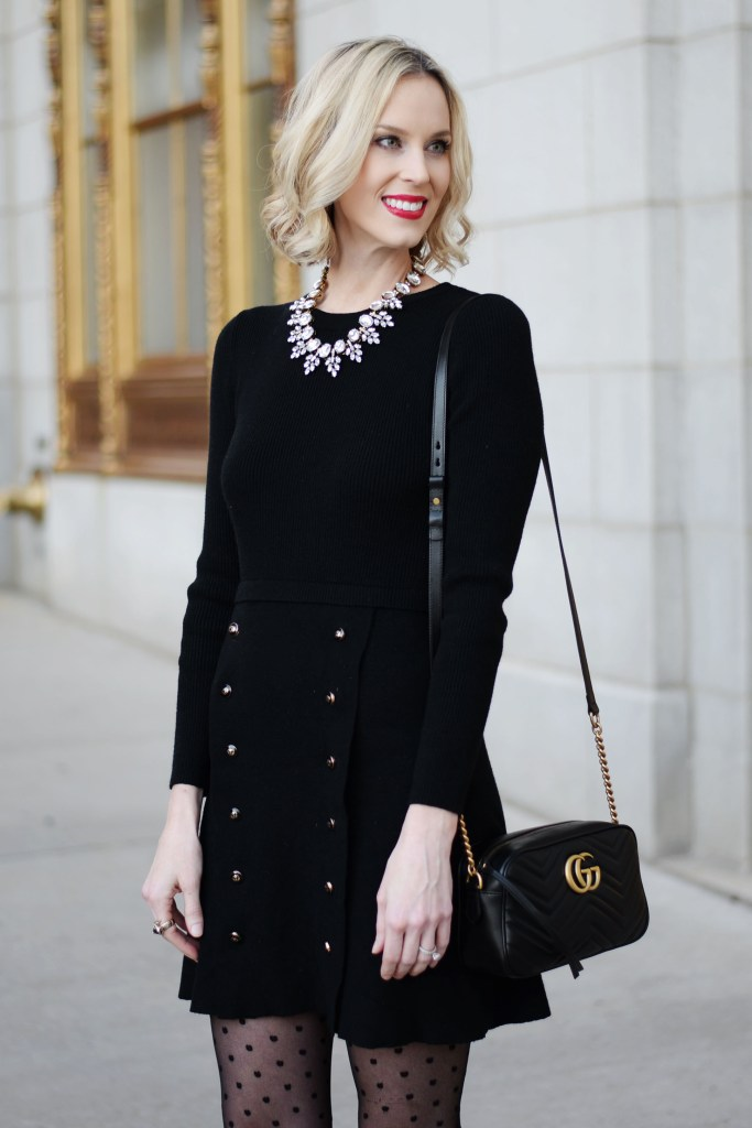 black sweater dress with gold buttons, statement crystal necklace