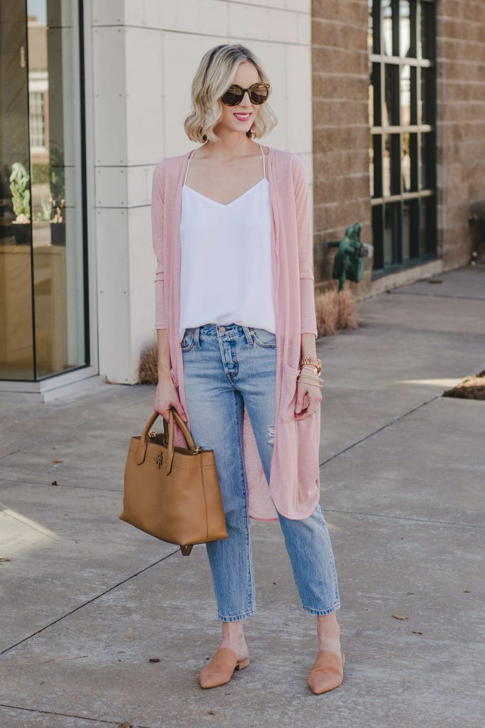 light pink duster cardigan, white camisole, light wash distressed jeans, tan slide mule shoes