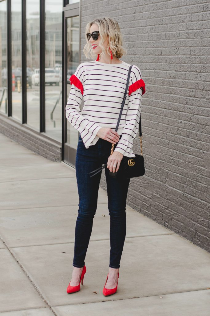 striped top with dark skinny jeans and heels