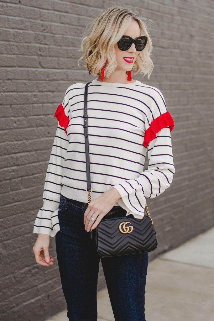 red ruffle top with red lipstick and red earrings, gucci bag