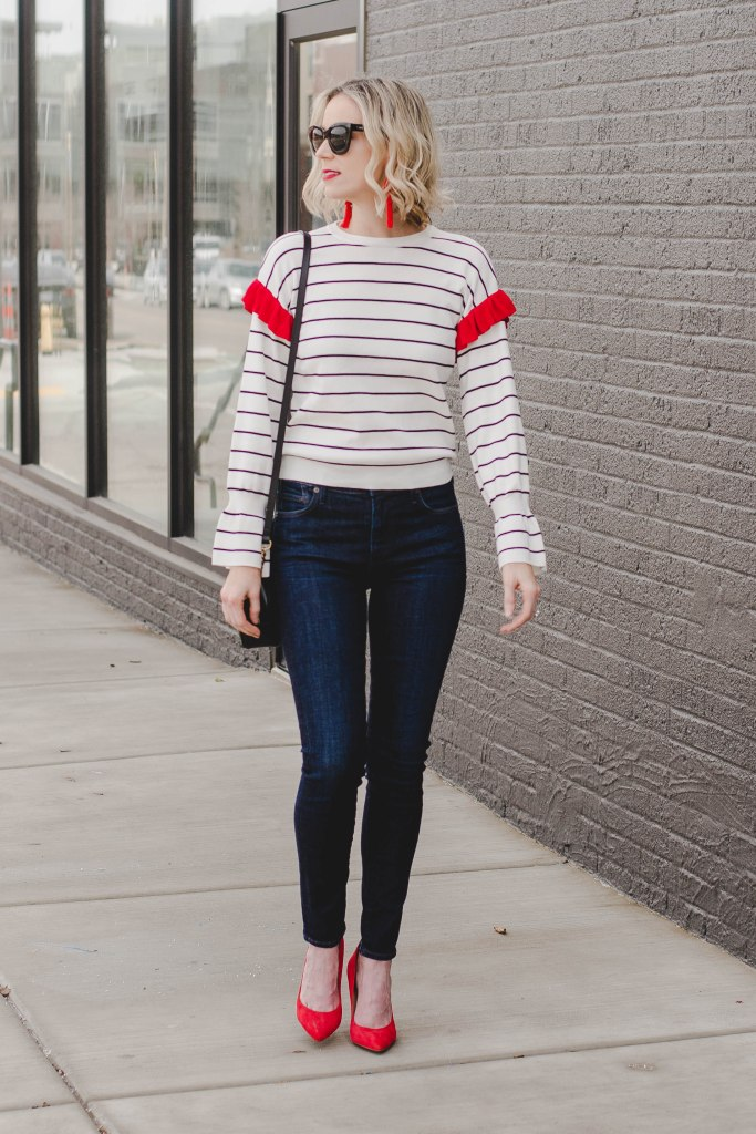 cute outfit idea for early spring, striped top with dark skinny jeans and heels