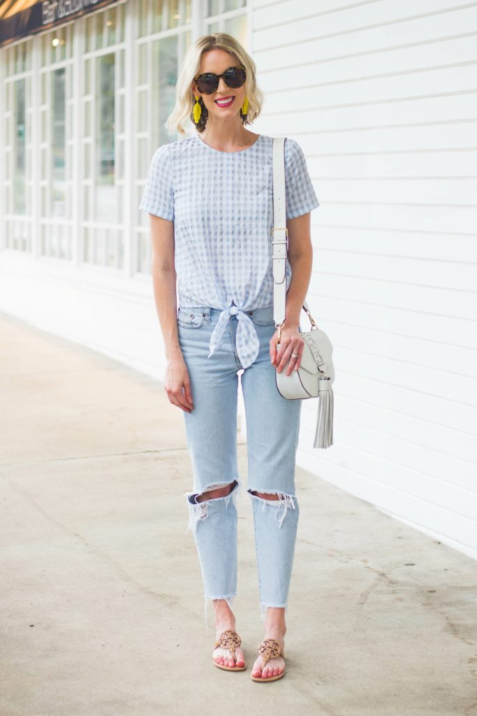 blue and white outfit with yellow earrings