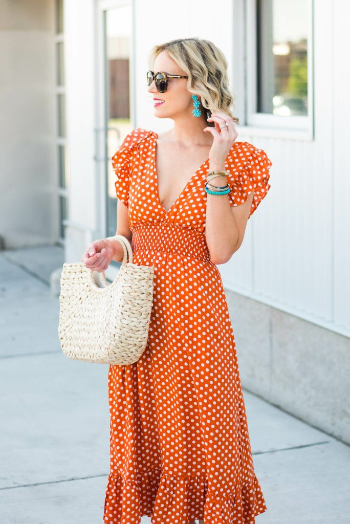 turquoise statement earrings with fun orange dress