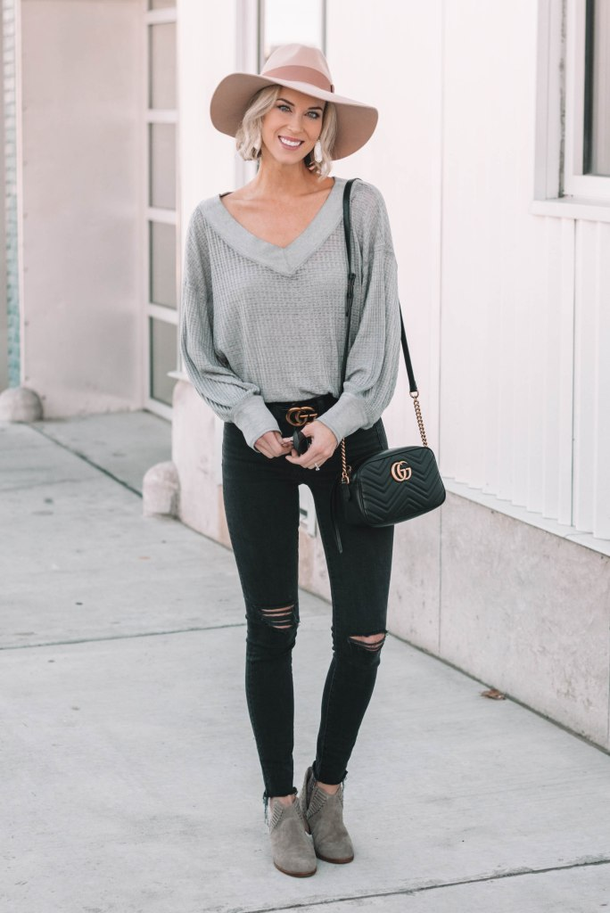 grey thermal Free People top with black skinny jeans and boots
