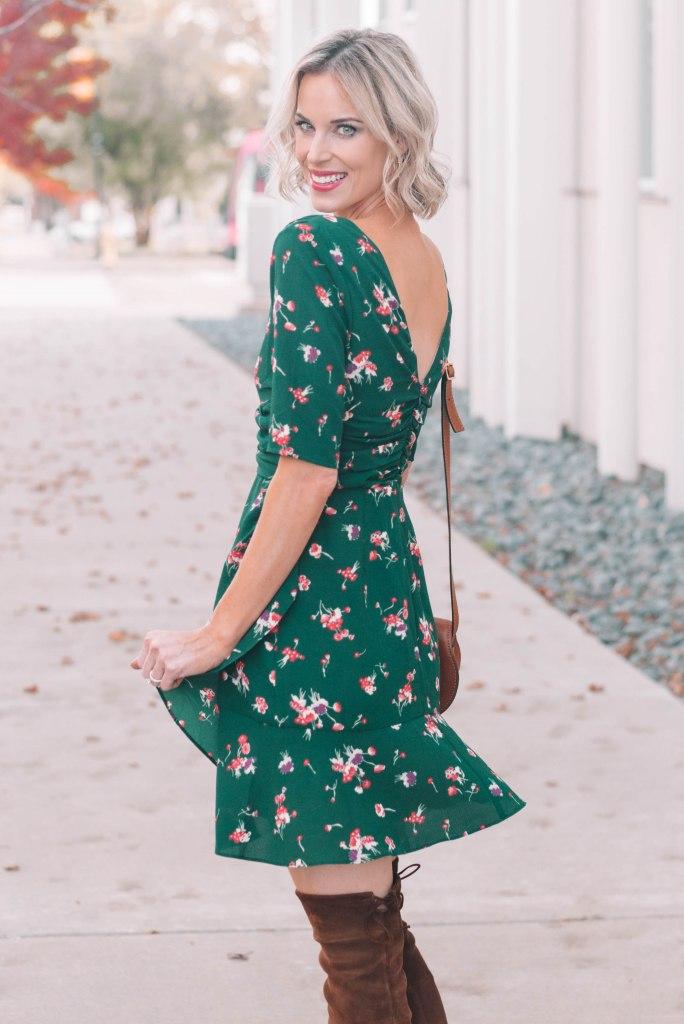 green mini dress with v back detail