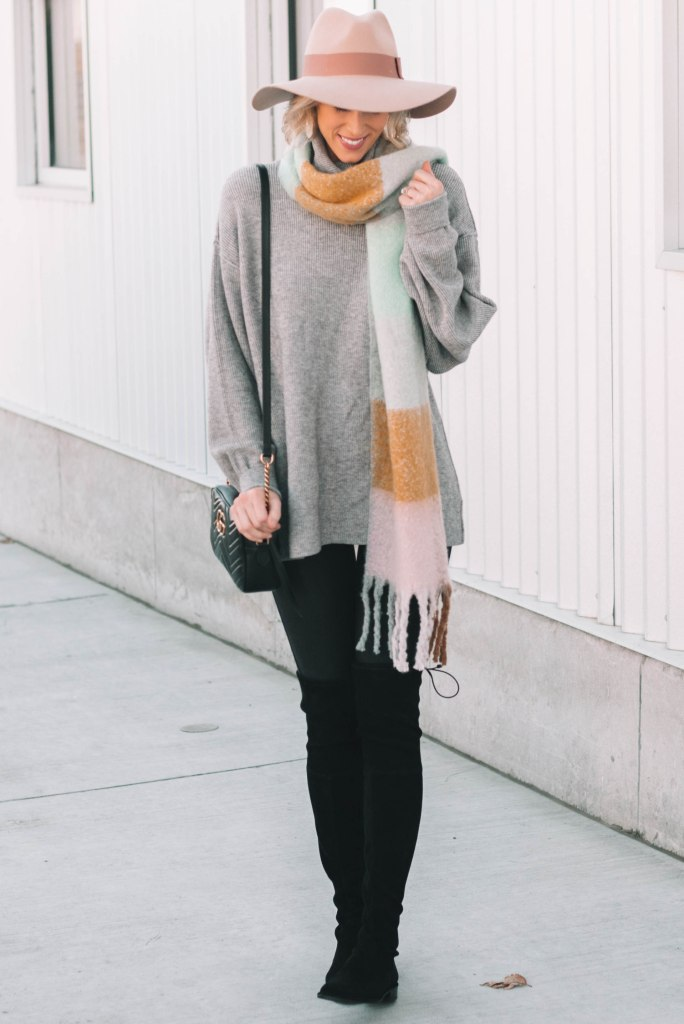faux leather leggings with long sweater and boots
