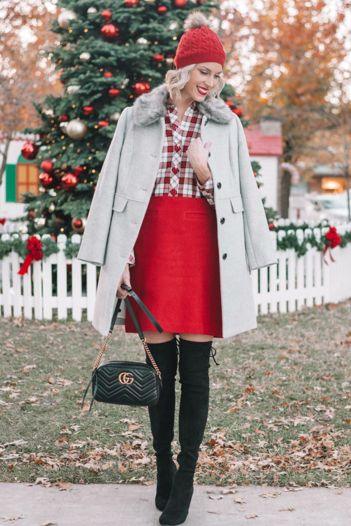 festive holiday outfit, red skirt, grey coat, plaid shirt