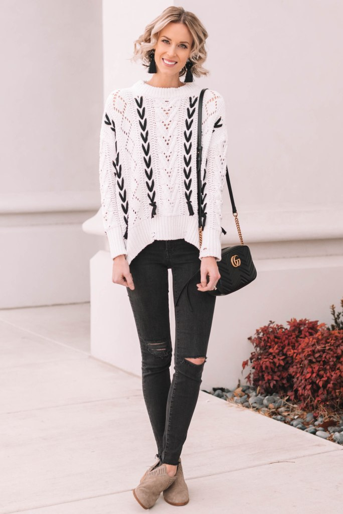 lace up sweater, white and black sweater with black skinny jeans and taupe boots