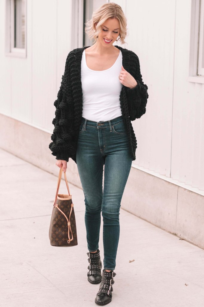 chunky black cardigan and jeans