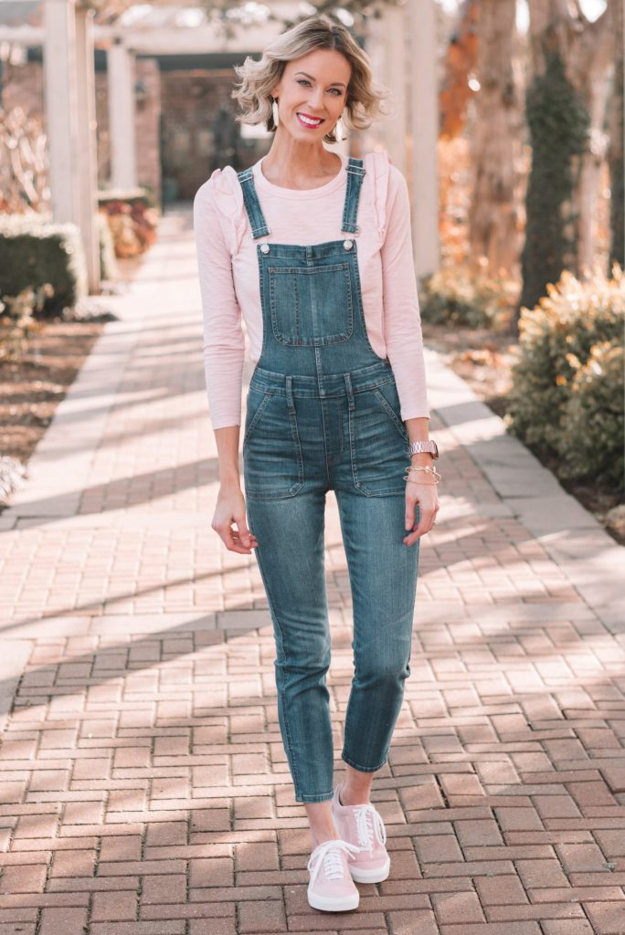 skinny denim overalls for spring with a pink top