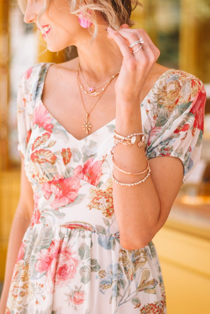 layered necklaces, pink earrings, stacked bracelets, Kendra Scott jewelry, floral dress