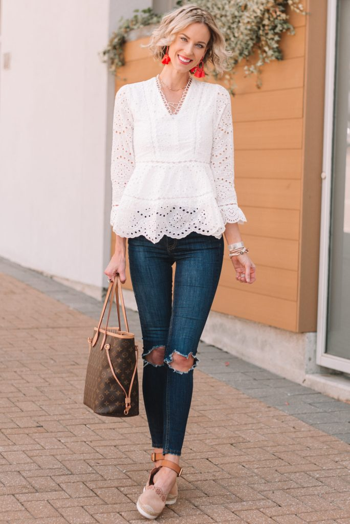 white peplum style eyelet top and skinny jeans for spring with statement earrings