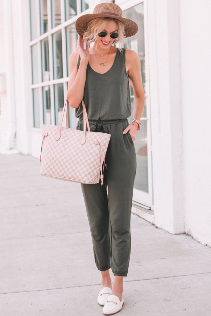 comfy and stylish olive jumpsuit for women, jumpsuit worn with mules and hat for summer