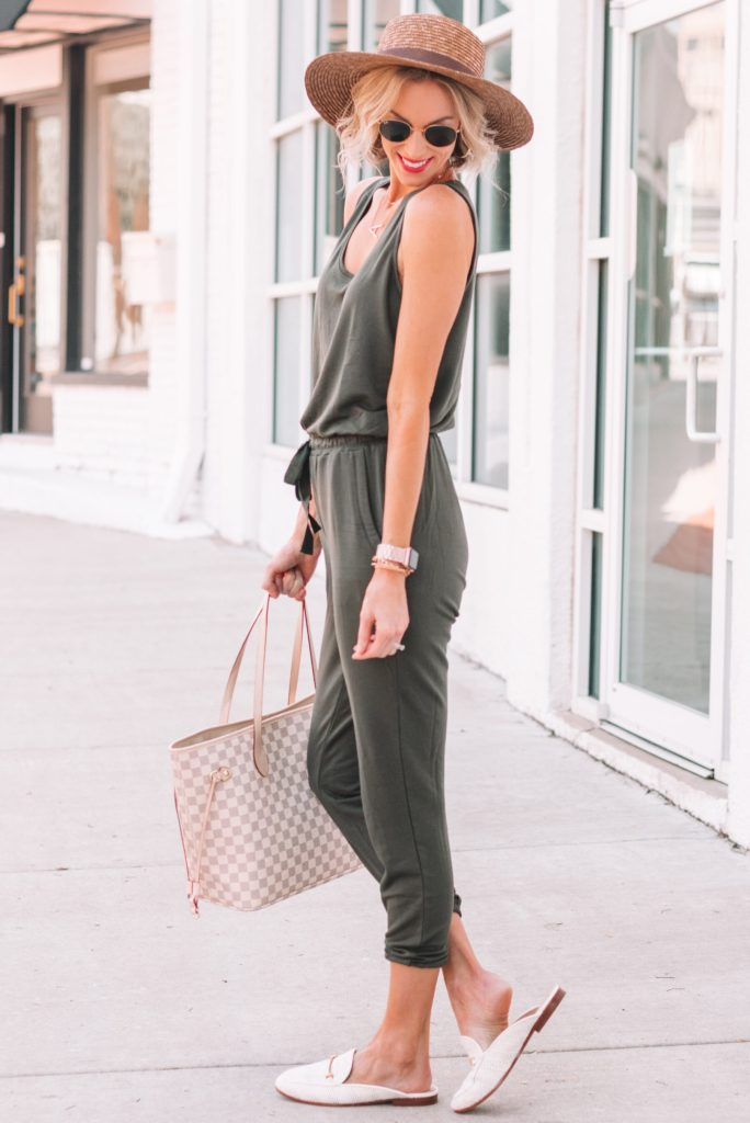 the comfiest olive jumpsuit styled with white mules and a hat for summer