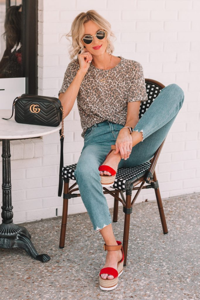 leopard shirt styled with mom jeans and red flatform sandals