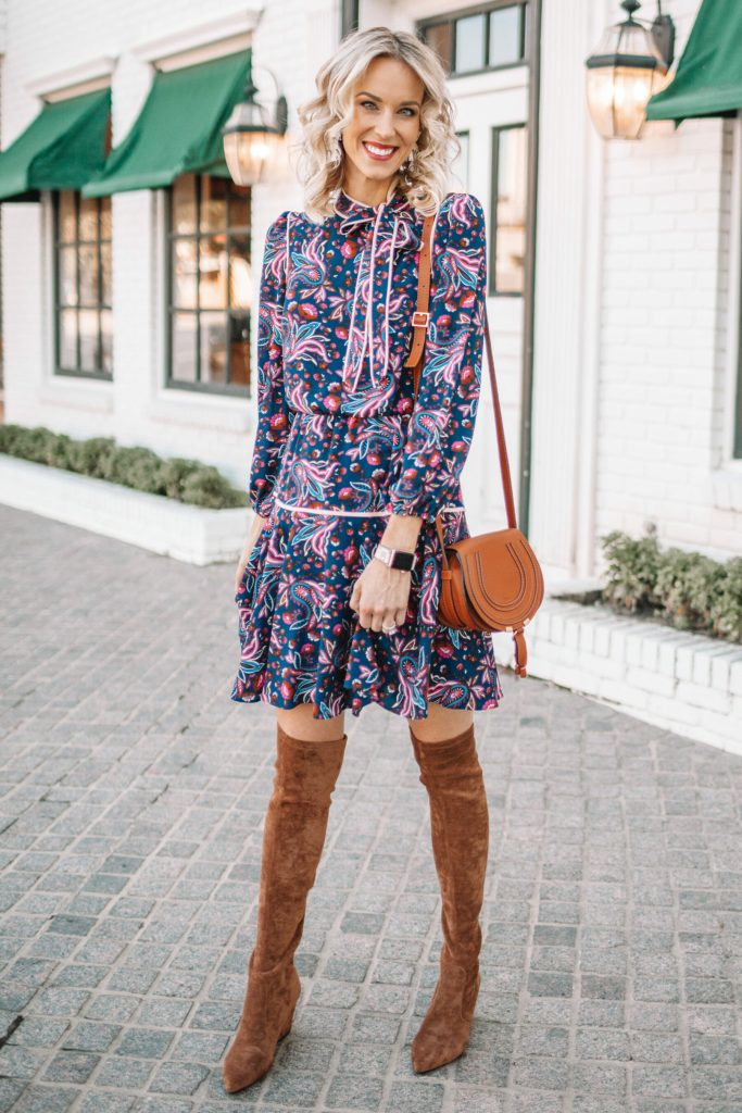 tank over the knee boots with a short dress