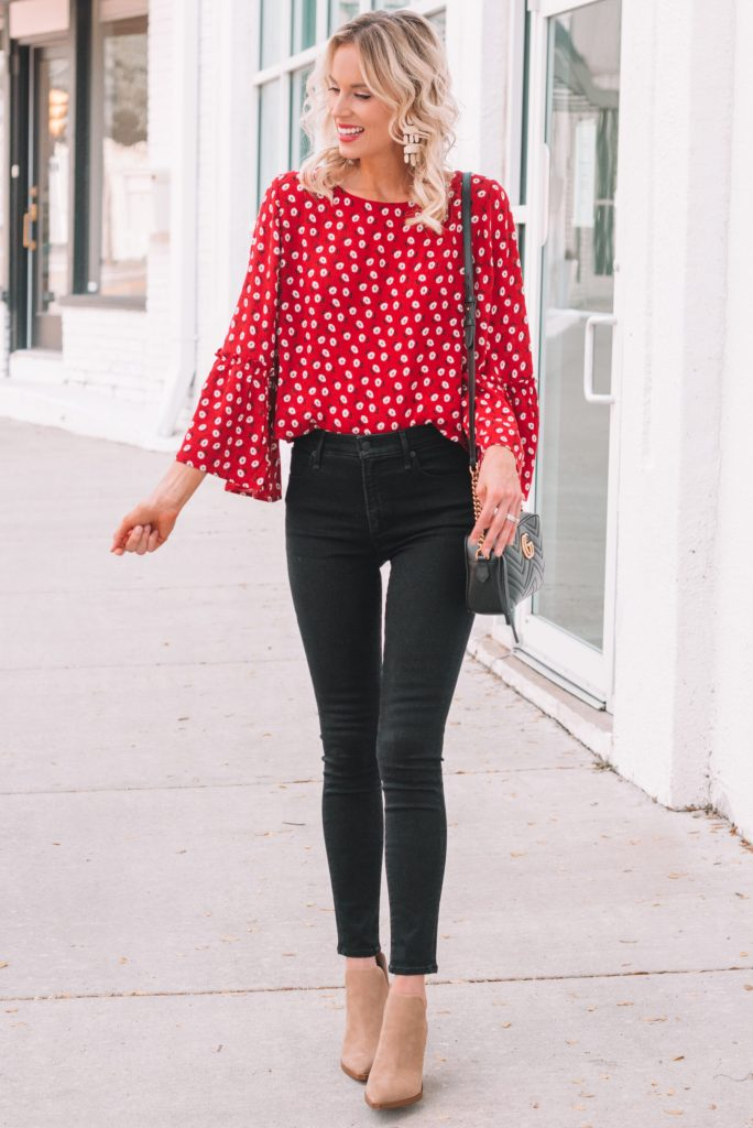 red blouse with black jeans and tan boties