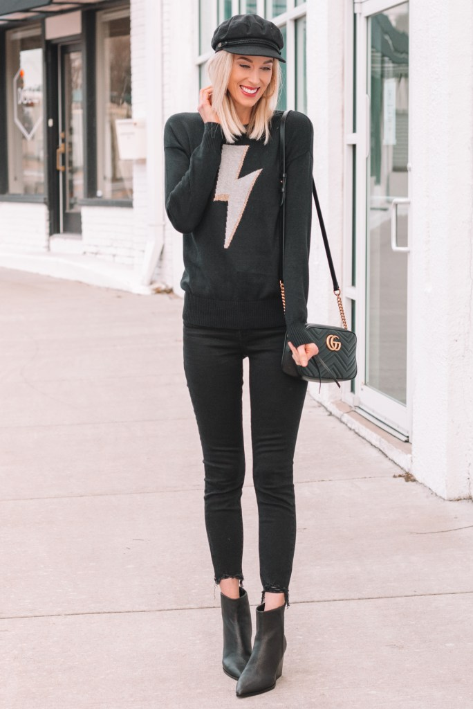 lightening bolt sweater, raw hem black jeans, black ankle booties
