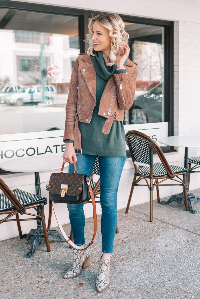 turtleneck tunic sweater with a suede moto jacket and snakeskin boots
