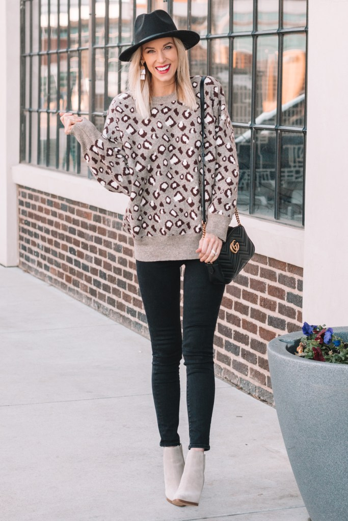 leopard sweater outfit, black jeans, boots