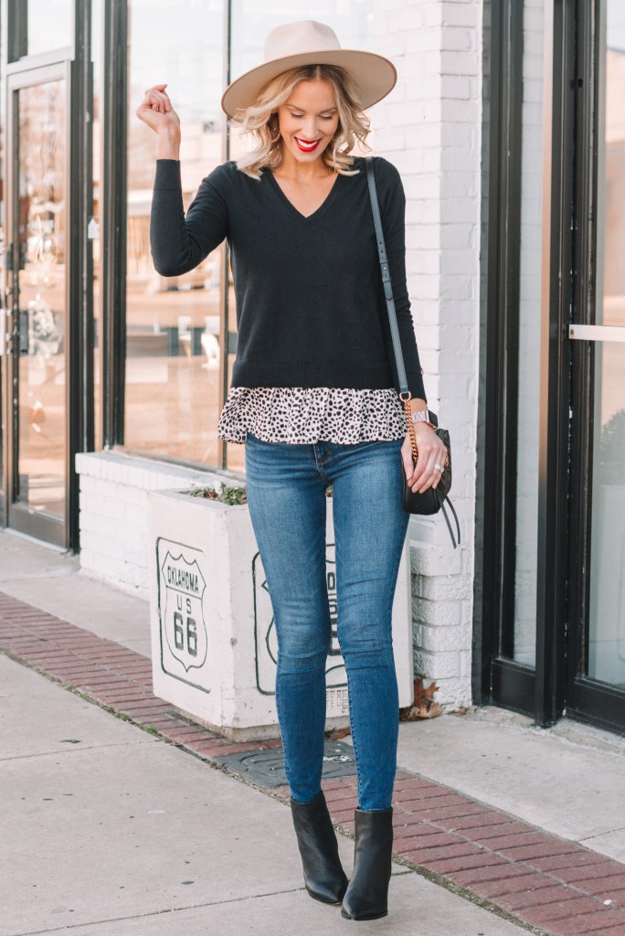faux layered peplum top, black v-neck sweater, jeans, lack of color hat, cream hat