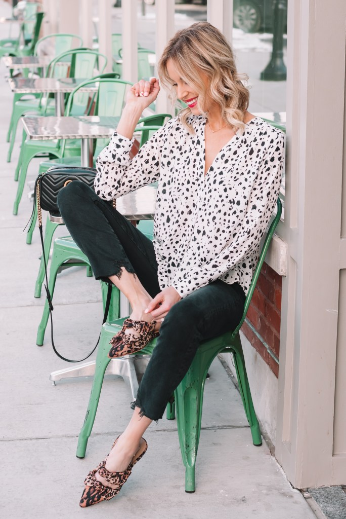 raw hem black jeans with black and white blouse
