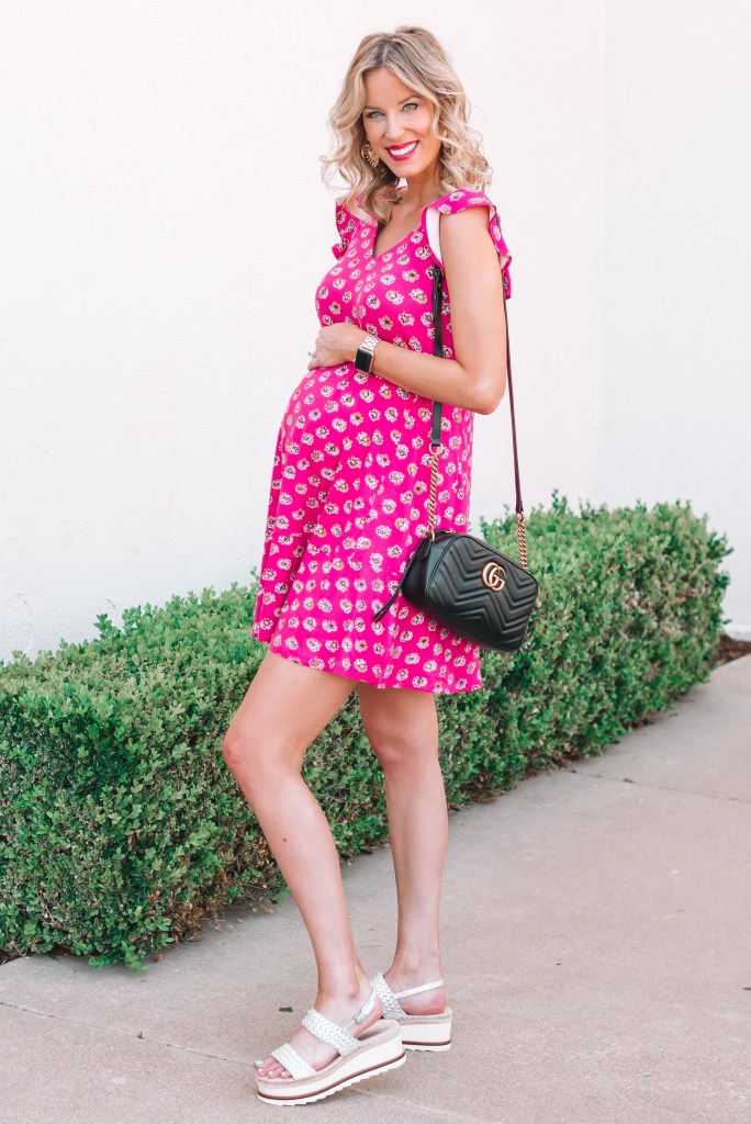 This non-maternity pink swing dress with flutter sleeves is the cutest and easiest thing to wear! I love that it's sleeveless and cool.