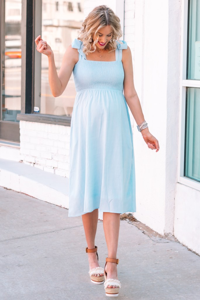 I love the tie shoulder detail on this smocked blue maternity dress!
