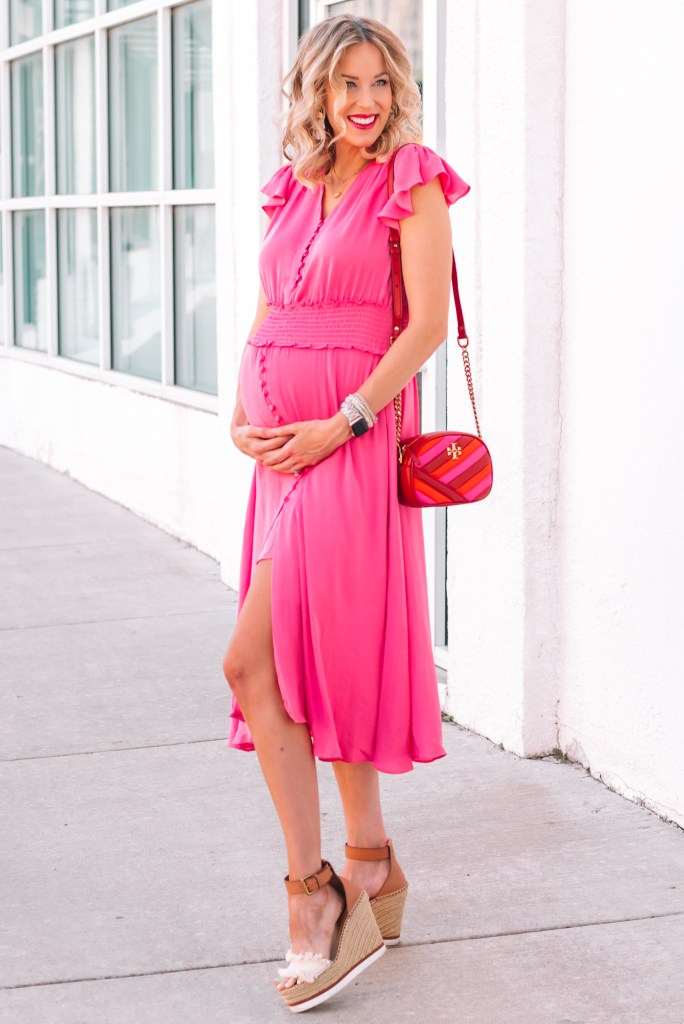 This dress seriously makes for the perfect pink girl baby shower dress! It's super flattering too.