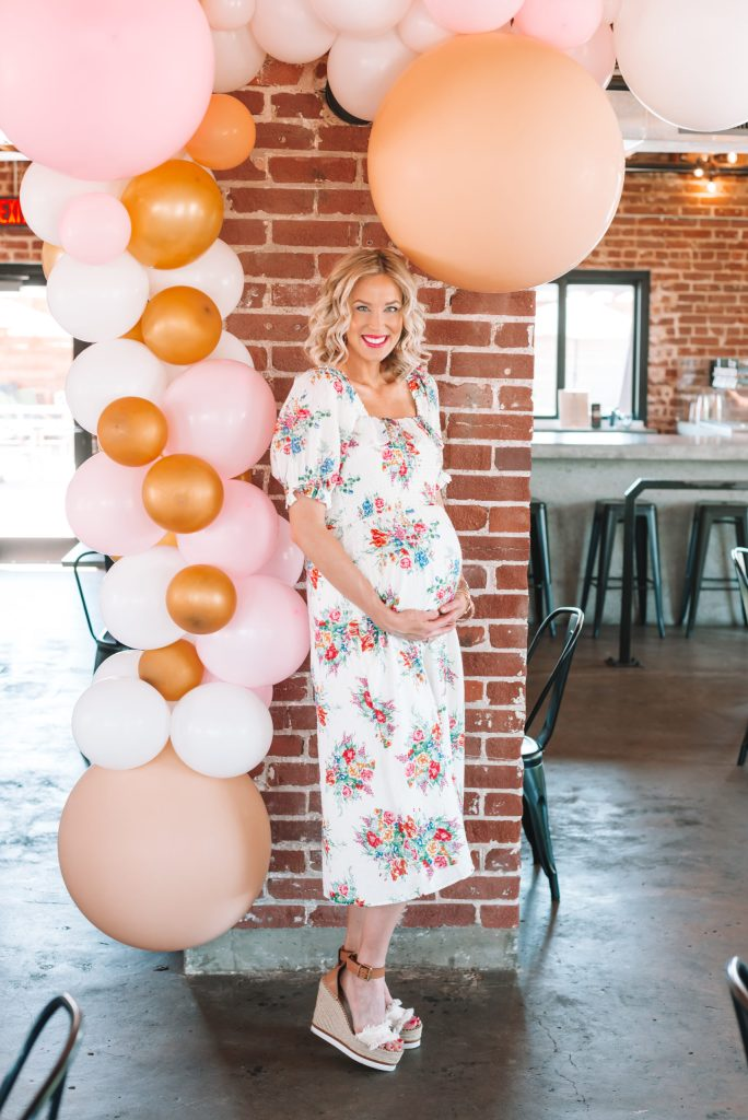 This white floral midi dress was PERFECT for my baby shower. It is non-maternity and super flattering. I love the smocked detailing.