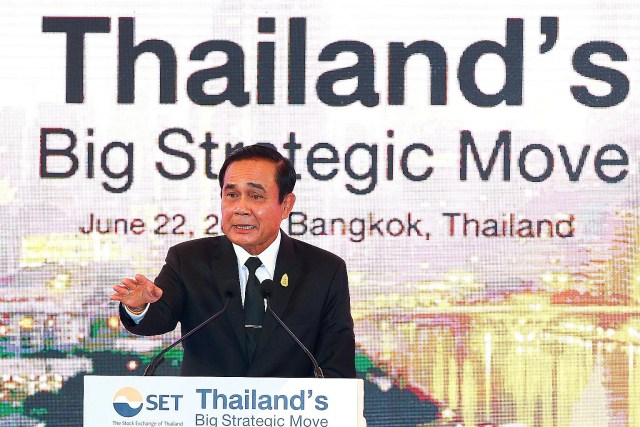 """Thai Prime Minister Prayut Chan-o-cha speaking to investors at the Big Strategic Move conference in Bangkok last week. Despite repeated assurances about holding a general election, the four politically charged questions he asked recently and his """"50"""