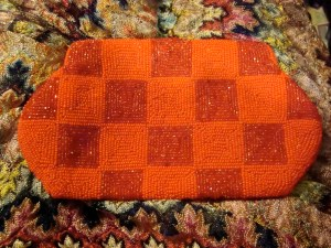 Red and orange beaded purse from Saks