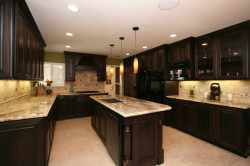 Brown Cabinets and Granite