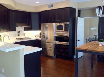 Dark Brown Cabinets and White countertop