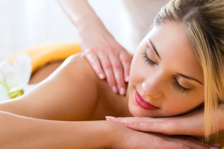 20954720 - wellness - woman receiving body or back massage in spa