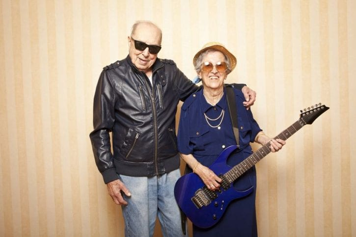 13787066 - cool fashion elder couple with electric guitar