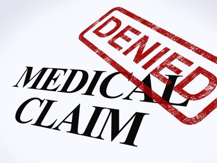 13965518 - medical claim denied stamp showing unsuccessful medical reimbursement