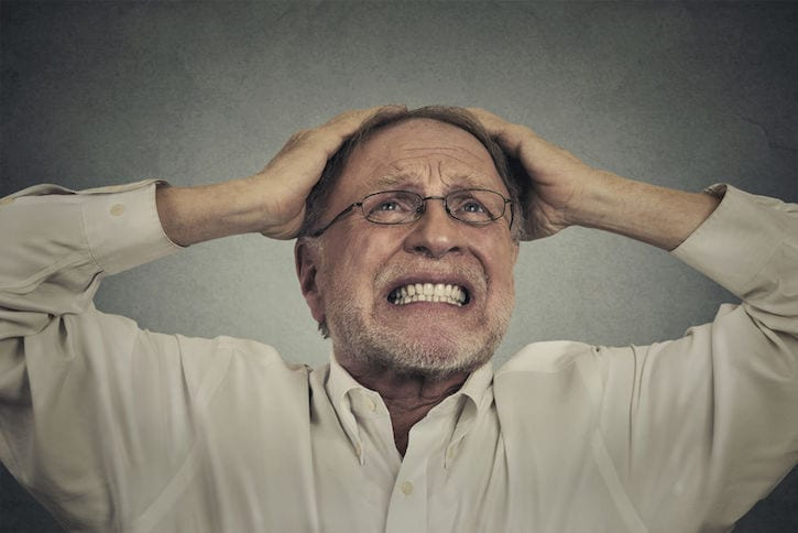 42813933 - closeup portrait headshot furious frustrated elderly man having bad hard day screaming looking up isolated on gray wall background. negative face expression emotion