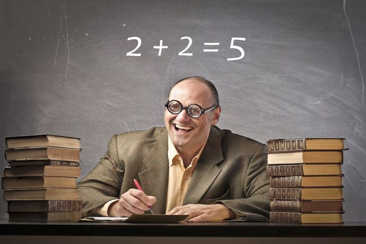 11571342 - smiling teacher with wrong calculation on the blackboard in the background