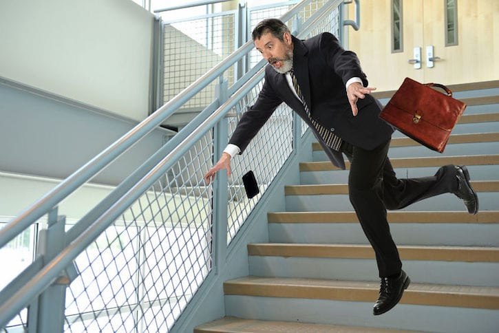 31850670 - senior hispanic businessman falling on stairs