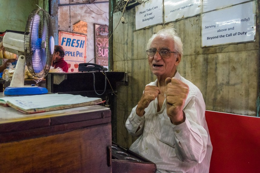 Parvez Irani, 76, strikes a pose in the Yazdani Bakery in Mumbai. Started by his father in 1950, the bakery is now run by him and two brothers.