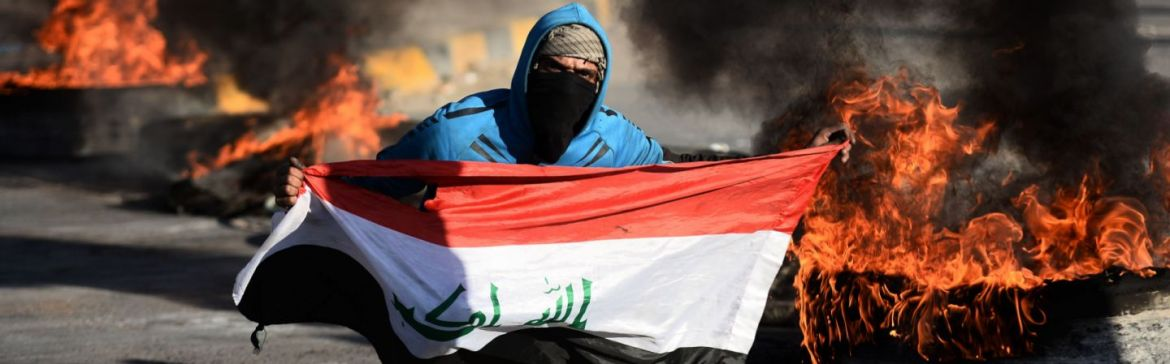 Image result for An Iraqi demonstrator poses with the national flag as angry protesters blocked roads in the central city of Najaf on Jan. 5, 2020, to oppose the possibility that Iraq would become a battleground between the United States and Iran. The killing of senior Iranian commander Qassem Soleimani has driven a wedge between Washington and Baghdad. (HAIDAR HAMDANI/AFP via Getty Images)