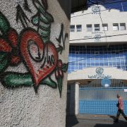 A Palestinian man walks past a shuttered health center provided by the United Nations Relief and Works Agency (UNRWA) during a strike of all UNRWA institutions in Rafah in the southern Gaza Strip on Sept. 24.