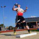 Student Lewis throwing shot put