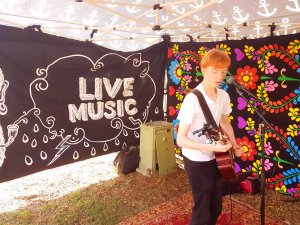 Daniel bracher performing at the markets whilst busking. Photo taken by Stratford Music. Live Music on the Central Coast.
