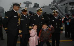 Rear Admiral AG Thapliyal, the Flag Officer Commanding Eastern Fleet with children during a welcome ceremony at Qingdao during the Chinese IFR.