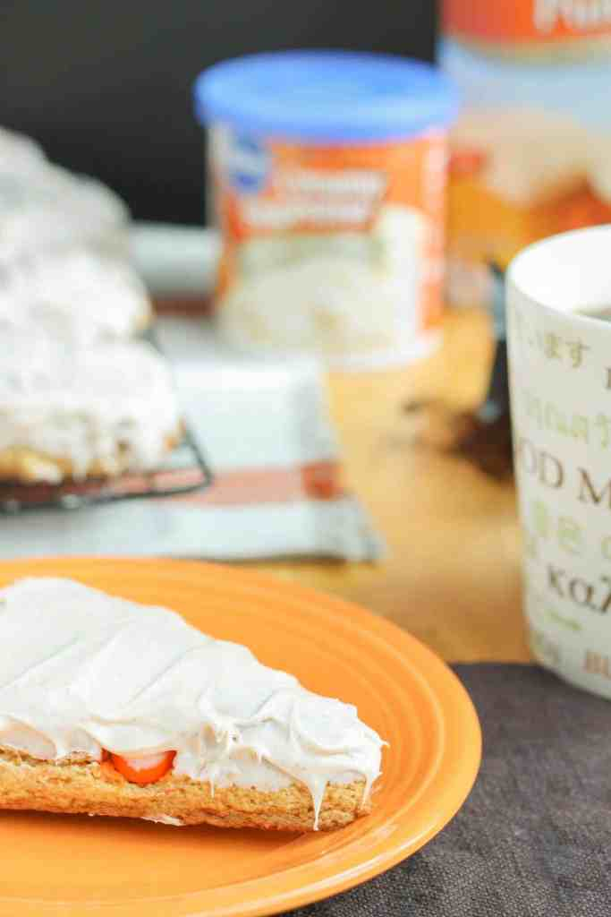 Wake up and enjoy the delicious flavors of fall with these scrumptious Pumpkin Spice Latte Scones. Made with pumpkin spice cake minx, pumpkin spice M&M's and topped with cinnamon cream cheese frosting, these are sure to start your morning off sweetly. | Strawberry Blondie Kitchen
