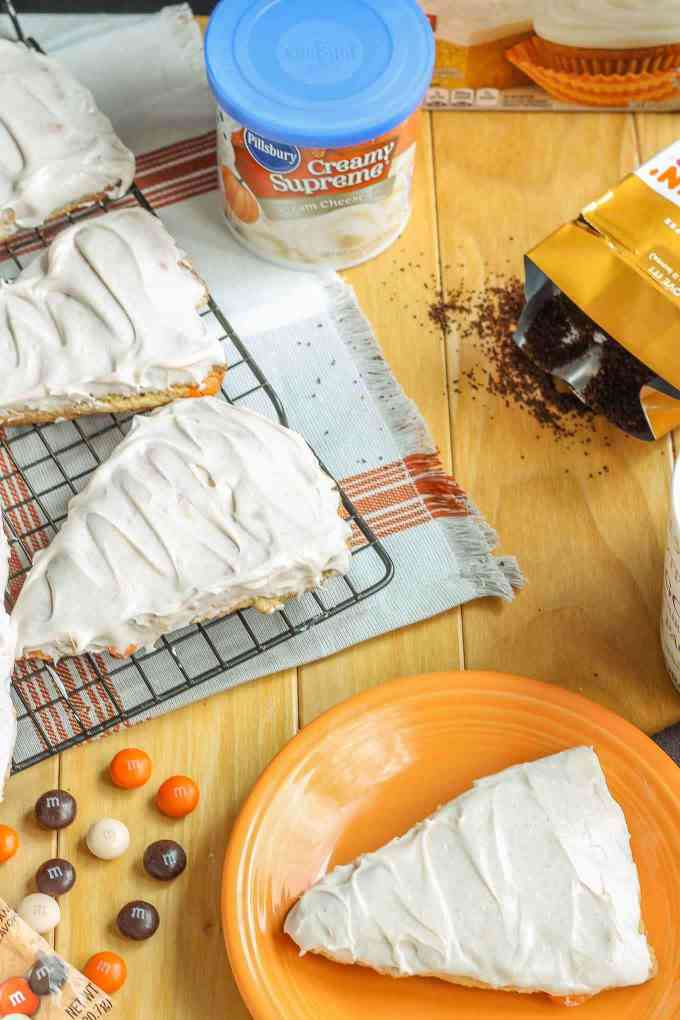 Wake up and enjoy the delicious flavors of fall with these scrumptious Pumpkin Spice Latte Scones. Made with pumpkin spice cake minx, pumpkin spice M&M's and topped with cinnamon cream cheese frosting, these are sure to start your morning off sweetly.