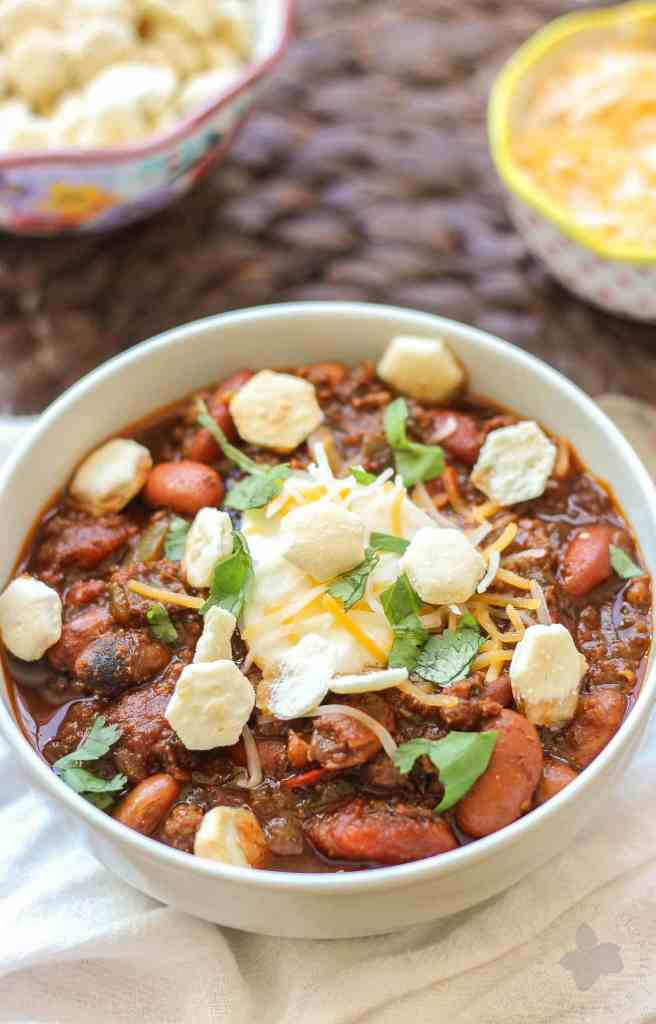 Chorizo Chili with Jalapeño Cornbread Waffles is perfect for game day, a chilly fall night or neighborhood potluck. This beefy flavored packed chili gets a slight kick from the spicy chorizo sausage. Served on top of cornbread waffles, dolloped with cheese and cilantro, and you've got yourself a well rounded meal!   Strawberry Blondie Kitchen
